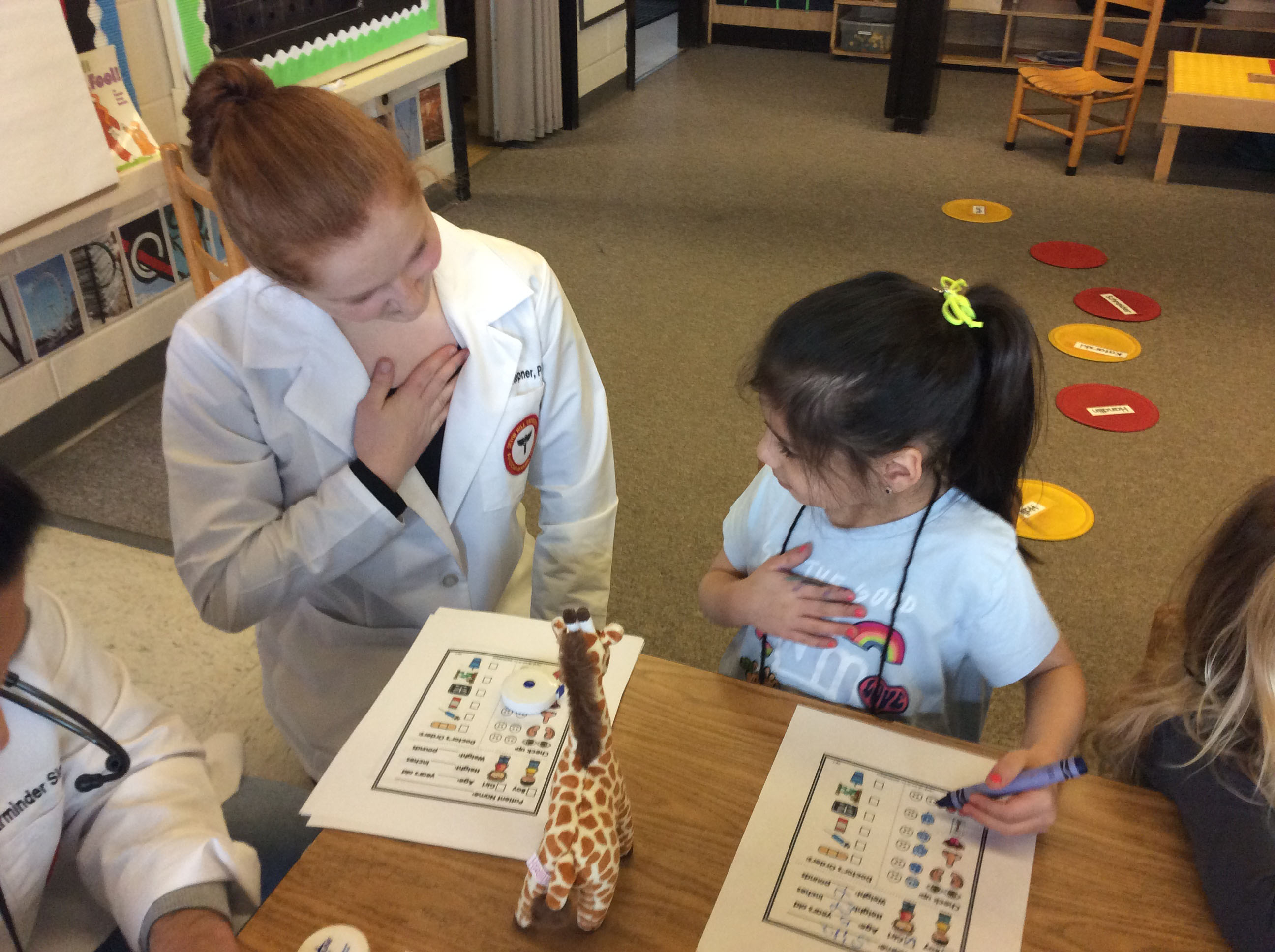 Physician Assistant graduate student with a student at Seton Hill's Child Development Center.