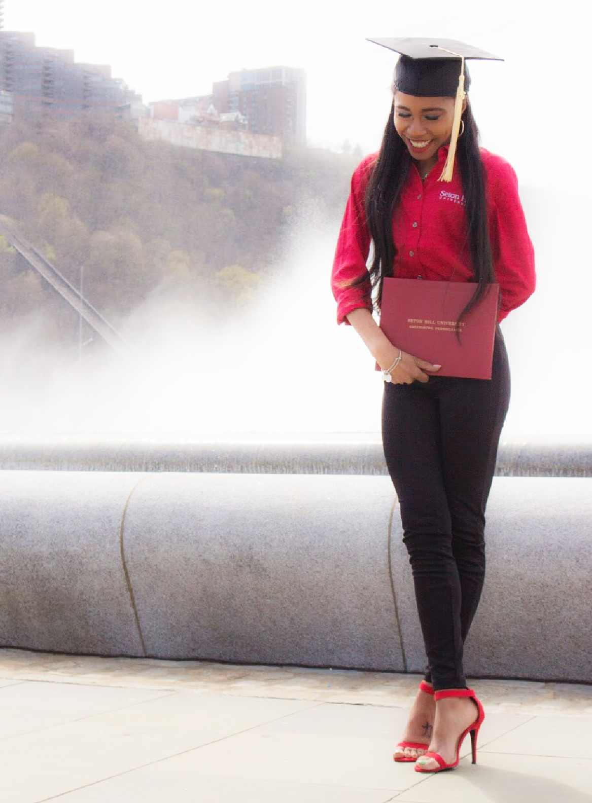 Jimiesha With Diploma in Front of Fountain in Pittsburgh