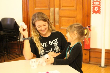 Seton Hill Elementary Education student works with student from the Child Development Center during their STEM Festival Day.