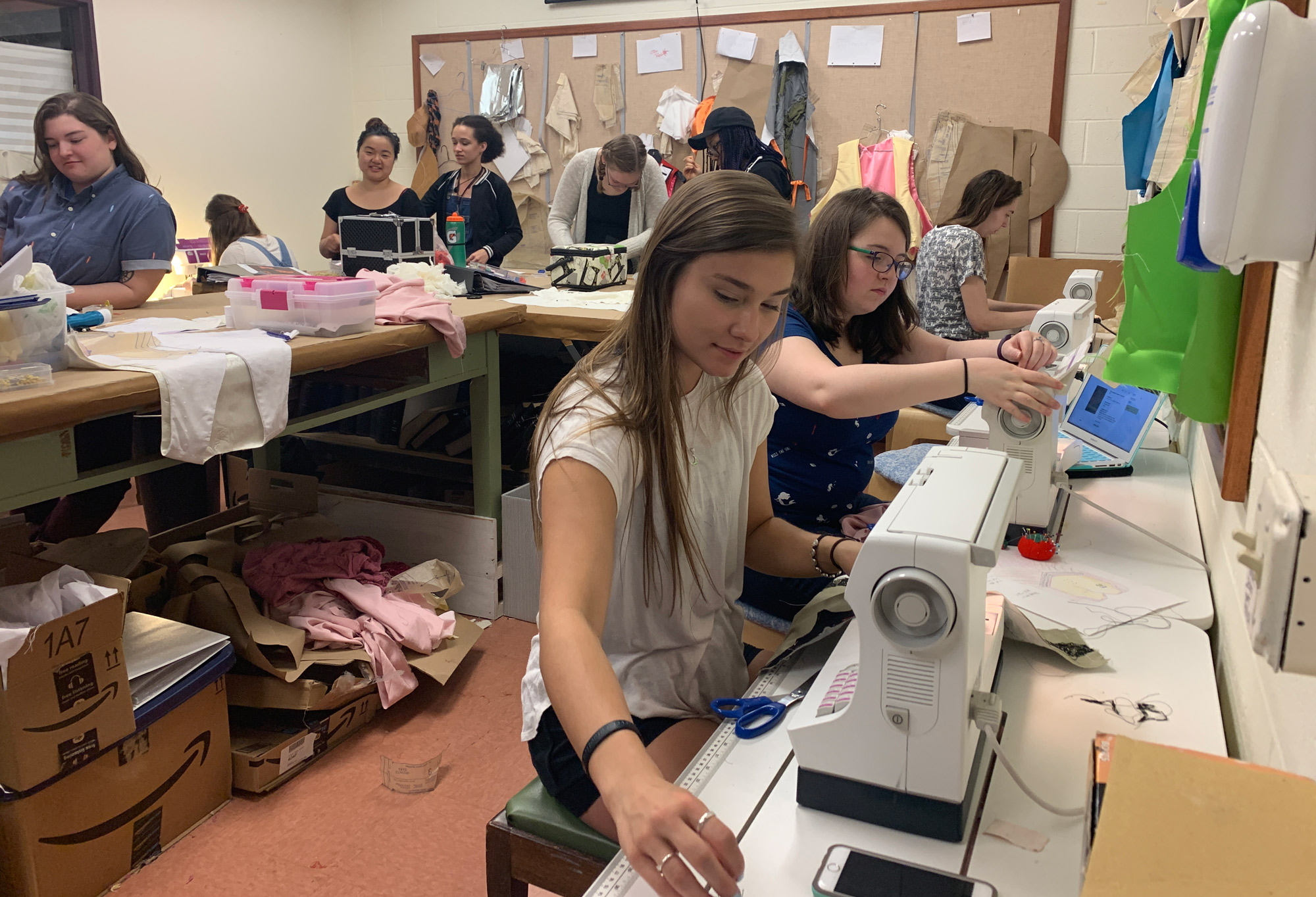 Students working at sewing machines