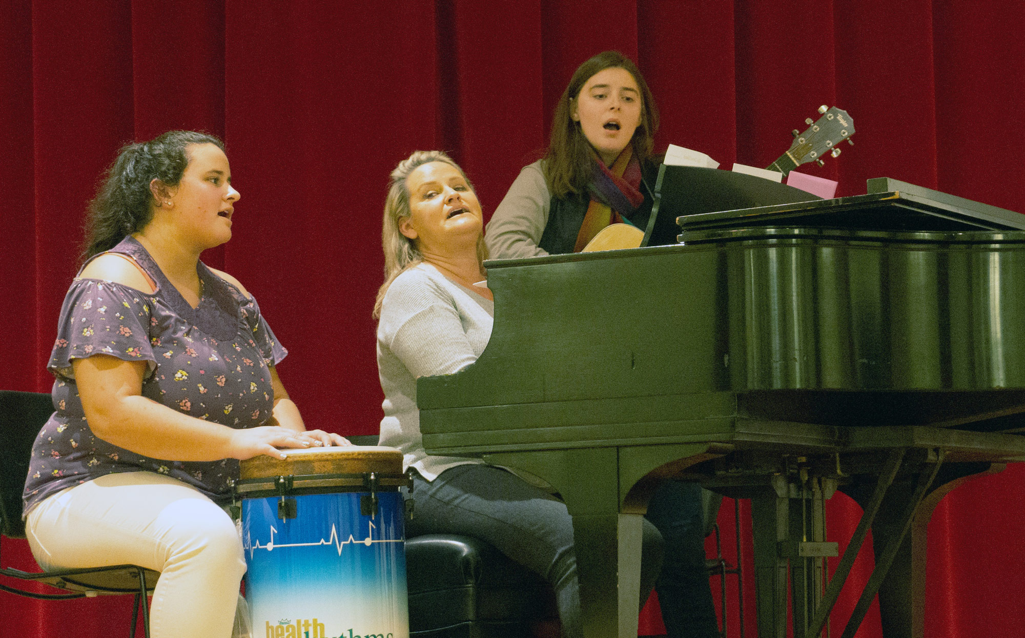 Students on drum and guitar accompany faculty member Laurie Fox on piano.